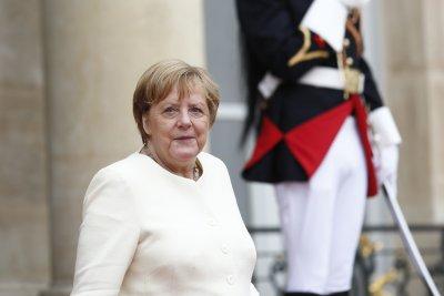 Защо Меркел диша тежко?