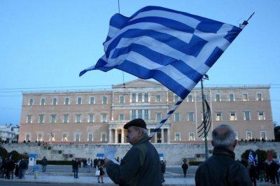 Гърция блокирана от стачка, и вестниците на бунт