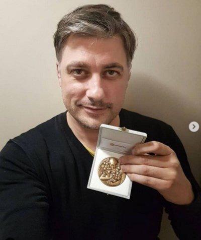 Владо Карамазов с бронзов медал от италиански фотографски конкурс